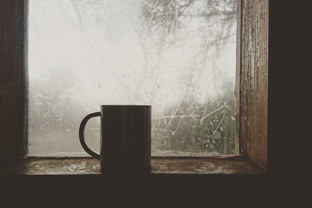 icy cold window with mug in front